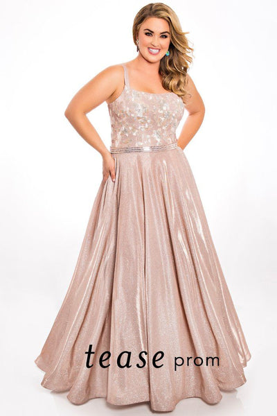TE2007 plus size formal dress is a glitter blush fabric with embroidered bodice, spaghetti straps and full pleated skirt with pockets.