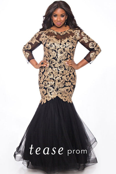 TE2022 plus size gold and black mermaid dress with 3/4 sleeves and fitted black tulle skirt. Embellished with gold appliques.