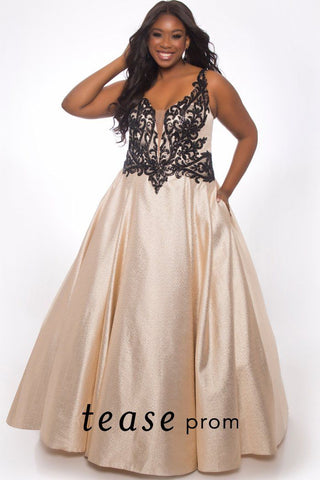 TE2023 plus size champagne and black formal dress with a deep V-bodice embellished with black appliques.  Full A-line champagne floor length skirt with pockets and center-back zipper.
