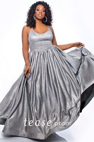 TE2030 plus size sterling silver gown with a scoop neckline, full pleated skirt in a metallic silver knit and crisscross spaghetti strap back detail.