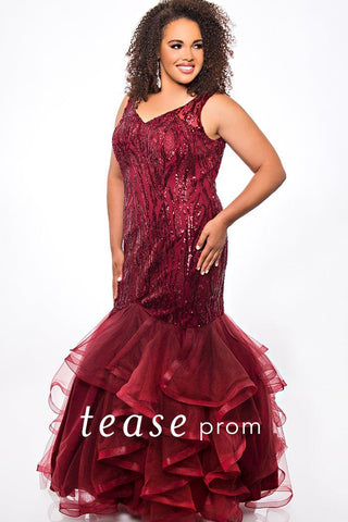 TE2048 burgundy or navy sexy mermaid sequin and tulle plus size dress.  V-bodice embellished with a sequin design, center-back zipper and floor length fitted tiered tulle skirt.