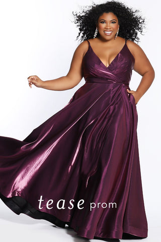 Prom Dress TE2103 by Sydney's Closet a-line with v-neck, pockets, and zipper back leg slit above the knee with shimmery fabric available in fuschia, teal and violet