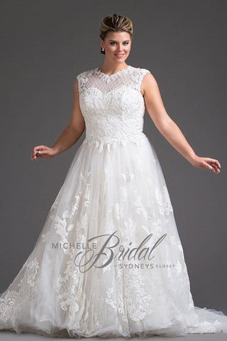MB1818 has a sweetheart neckline with tone-on-tone sequined window pane pattern and cap sleeves.  Natural waistline with full A-line skirt and chapel train