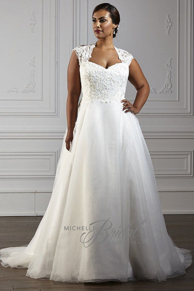 MB1608 has a sweetheart neckline with pearls and sequins on the bodice and has a A-line skirt with lace up corset back