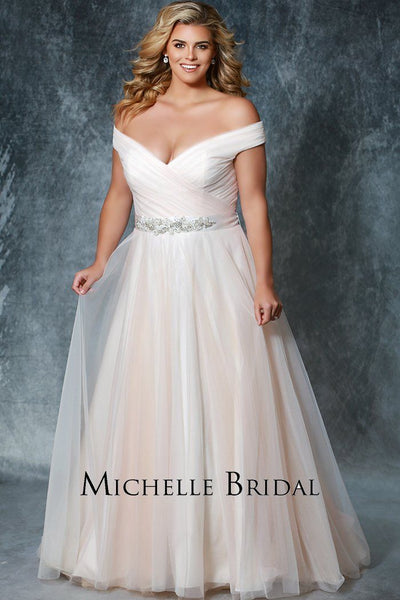 MB1812 has a pleated V-bodice with beaded belt and lace-up back with modesty panel. A natural waistline and A-line tulle skirt with chapel train