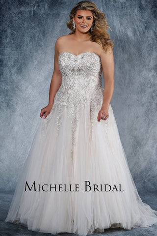 MB1819 is a strapless sweetheart neckline wedding dress with a heavily beaded bodice in both clear and silver beads.  Full tulle skirt with chapel train