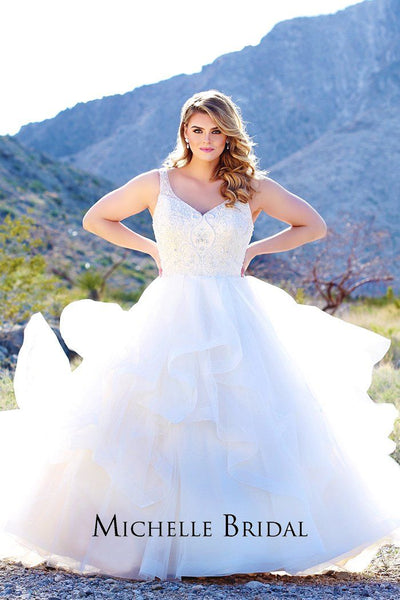 MB1901 plus size bridal dress with V-neckline, beaded illusion straps, center-back zipper and full tiered ball gown skirt.
