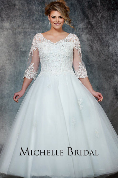 MB1906 lace and tulle plus size bridal gown with V-bodice, 3/4 length sleeves, lace appliques, lace-up back and full tulle over satin skirt.