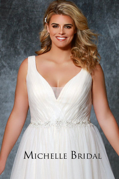MB1935 romantic plus size wedding dress with soft pleated bra-friendly bodice, delicate beaded belt and tulle skirt. Available in ivory, champagne or blush