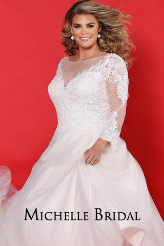 MB2008 plus size bridal dress with a ball gown silhouette, sweetheart lace bodice and illusion sleeves with covered buttons.  Full tulle skirt with lace-up back.