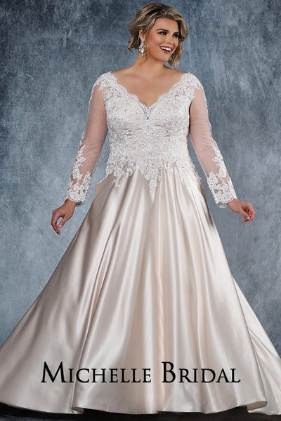 MB2014 lace and satin plus size bridal gown with scalloped V-neckline, illusion mesh sleeves, full satin skirt with pockets. Center-back zipper with covered buttons.