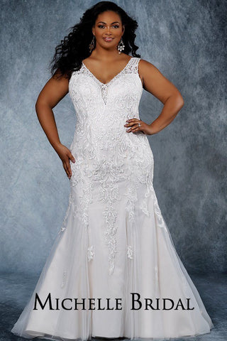 MB2015 fitted mermaid plus size bridal gown with V-neckline, lace straps and pearl beaded appliques.  Fitted tulle floor length skirt, lace-up back and chapel train.