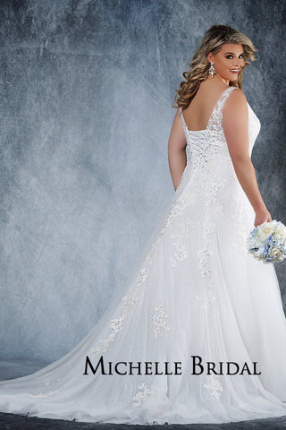 MB2019 plus size ivory bridal gown with an A-line silhouette, V-neckline, bodice, tulle and organza skirt with floral lace appliques. Lace-up back with modesty panel and chapel train.
