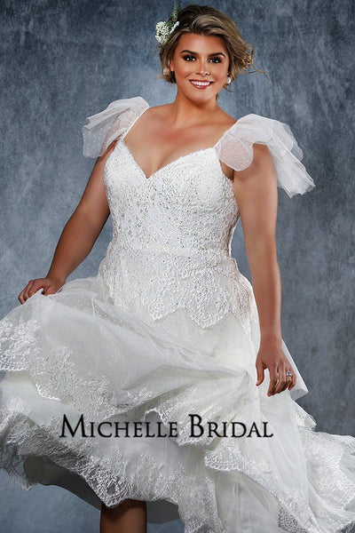 MB2023 boho inspired plus size bridal dress with tiered lace skirt, flutter sleeves, semi-sweetheart bodice and lace scalloped train.