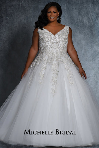 Kelly Bridal Gown MB2115 by Sydney's Closet A-line ballgown with bra friendly straps and lace up back heavily beaded bodice with appliques available in ivory/ivory, ivory/champagne