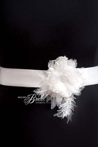bridal sash embellished with feathers and flowers