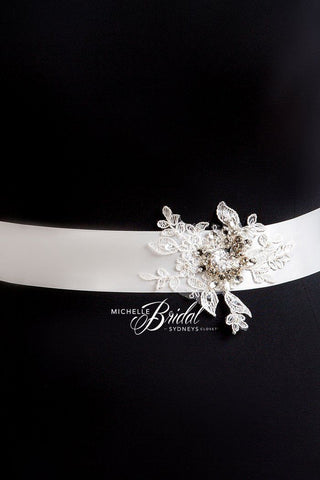 MB3302 has hand cut lace appliques embellished with rhinestones on this satin bridal sash