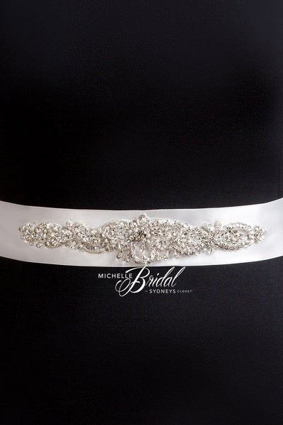 MB3303 bridal belt features a classic center front motif that tapers down at the sides has beads, sequins and rhinestones