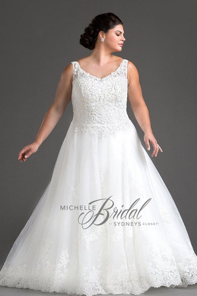 MB1809 has a sweetheart bodice with lace overlay and lace-up back with modesty panel. A-line glitter tulle skirt Chapel train with lace scalloped hem
