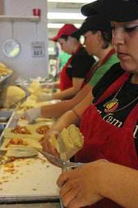 Tucson Tamale staff rolling fresh steamed tamales