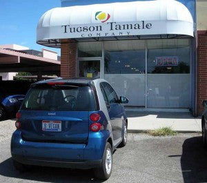 "car in front of tamale restaurant with ""B Vegan"" license plate."