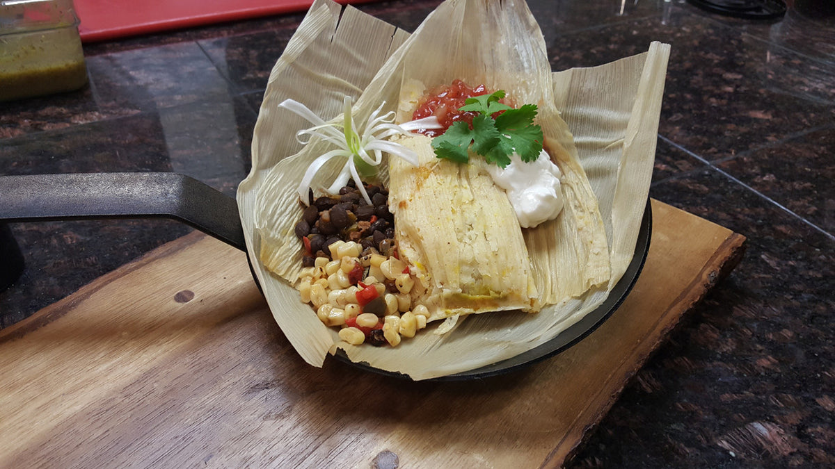 skillet filled with tamales and fresh corn and bean salad