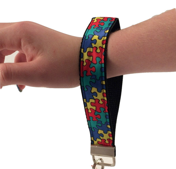 Autism Awareness Puzzle Key Chain / Keyfob with black backing and a sturdy 12 inch wrist loop