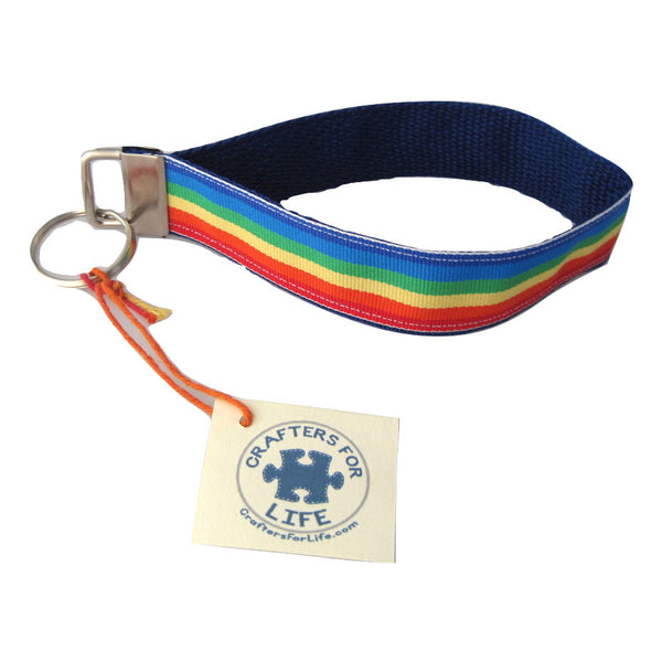 Rainbow Stripe Key Chain with Blue Backing and a sturdy 12 inch wrist loop - made by Adults with Special Needs