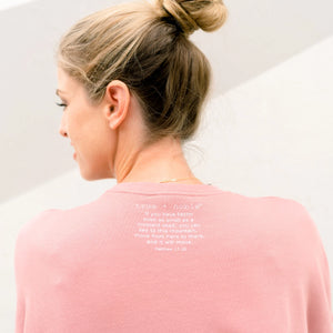 This trendy Christian Sweatshirt adds another great design to true + noble's Christian clothing line. As a reminder that faith can move mountains, Matthew 17:20 is printed on the back of each t-shirt. Christian apparel has never been so fashionable.