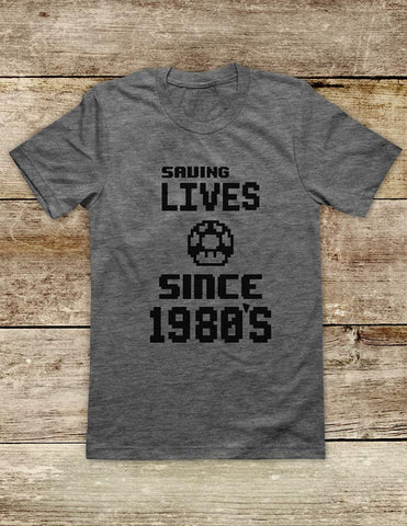 Saving Lives Since 1980's retro vintage Video Game Soft Unisex Men or Women Short Sleeve Jersey Tee Shirt