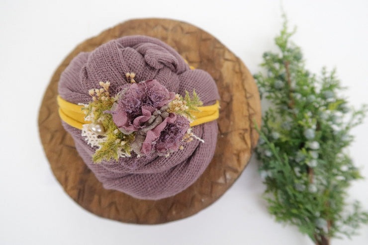 purple and yellow newborn baby girl photography prop set. flower headband and matching swaddle wrap