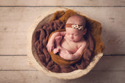 bronze copper newborn baby girl in bowl with other matching photo props