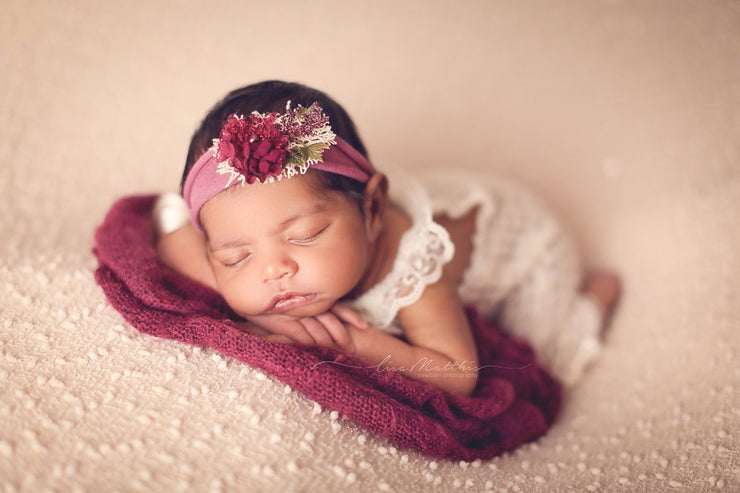 magenta pink newborn baby headband with adjustable band on newborn girl