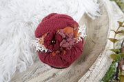 red swaddling wrap and matching flower headband with red and mauve flowers photography props