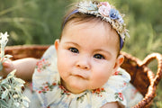 little girl with handmade blue and pink headband
