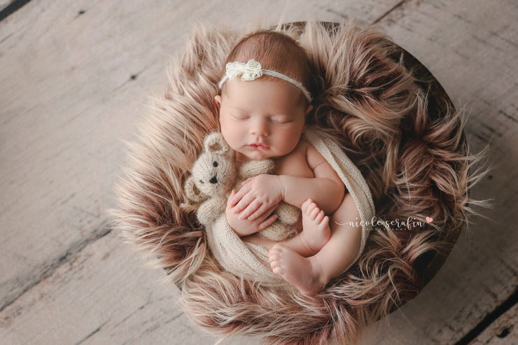 long, two tone straight, newborn faux fur photo prop with baby girl holding small bear