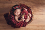 newborn baby red swaddling wrap on baby girl for baby's newborn pictures. Props by Custom Photo Props