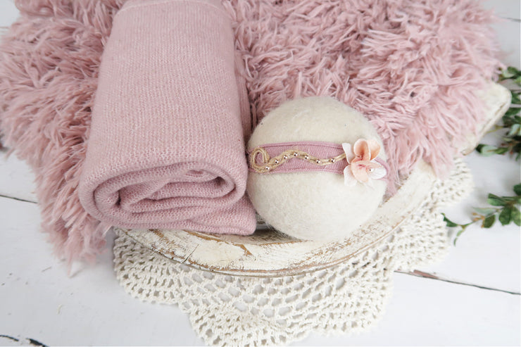 pink newborn baby prop set with matching swaddle wrap, fur and flower headband