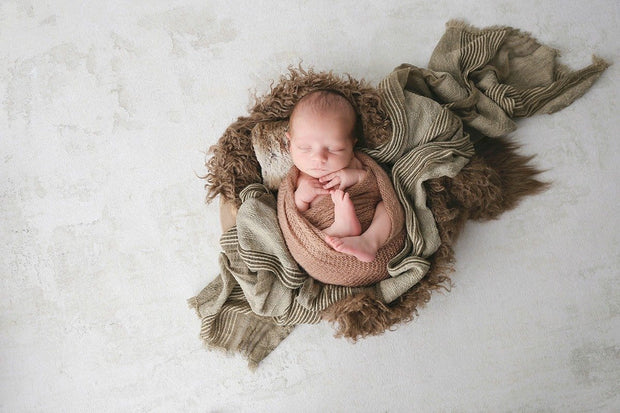 textured brown faux fur with custom photo props flokati fur with baby boy in bowl and layering fabrics