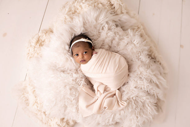 vegan faux flokati newborn fur in white with african american baby girl