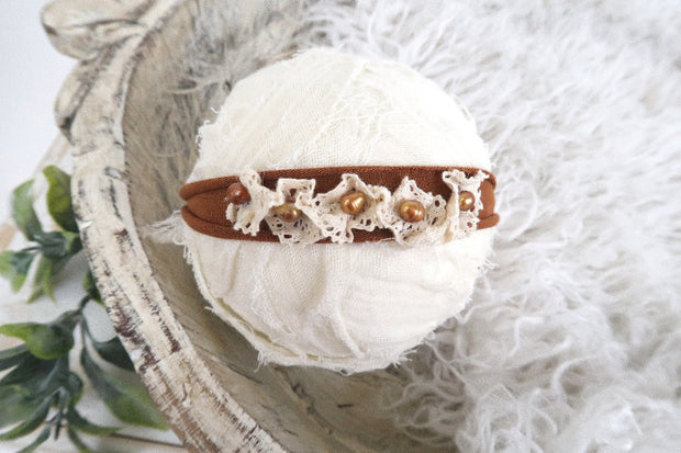 rusted brown newborn baby headband with lace and matching pearls. photography props by custom photo props