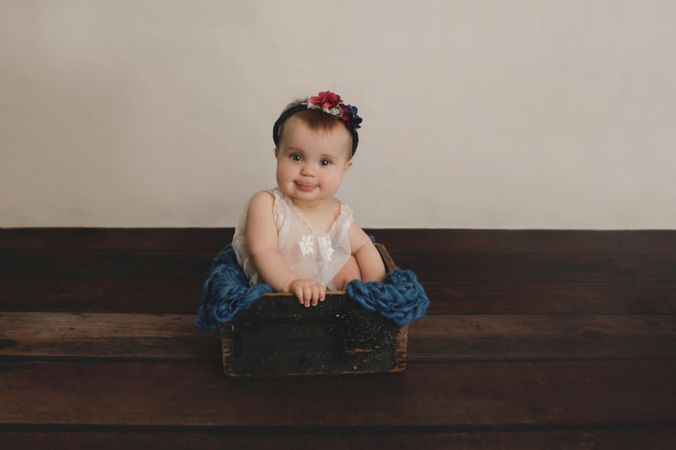 sitter girl in old crate with knit blanket, halo photography prop