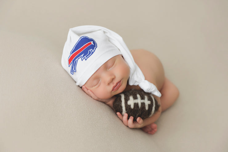 newborn baby boy with small felted football and bills hat fo rnewbor photos