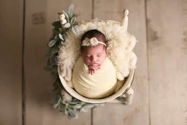 newborn baby photography prop set in all ivory, fur, headband on chair