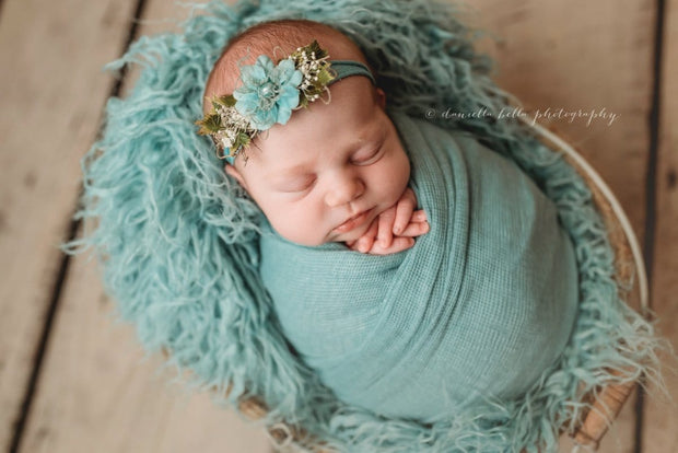light turquoise or aqua blue swaddling wrap on baby girl newborn pictures