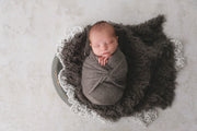 dark gray faux flokati fur for newborn baby photographs
