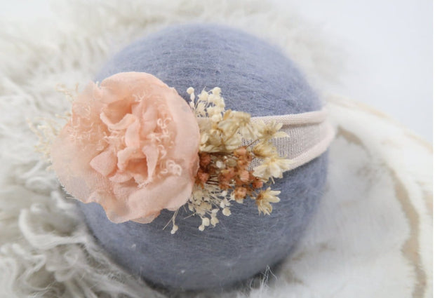 side view peach newborn baby girl headband with cream band, dried flowers, petal, newborn photo prop