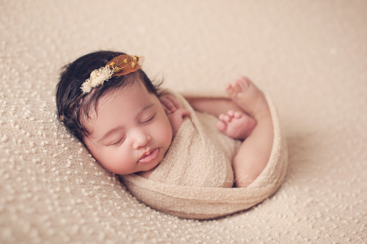 Indian baby girl with beautiful natural headband for baby pictures