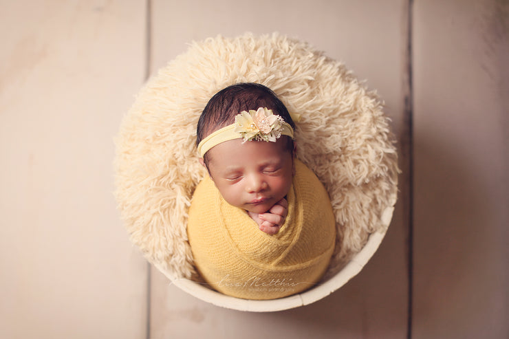 newborn girl in yellow swaddling wrap and matching headband photo prop by Custom Photo props