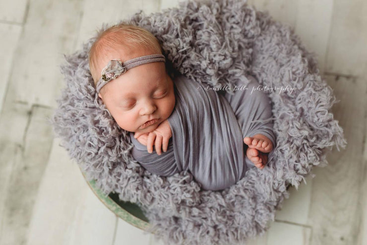 dusty purple newborn baby faux fur photography prop of baby girl in bowl